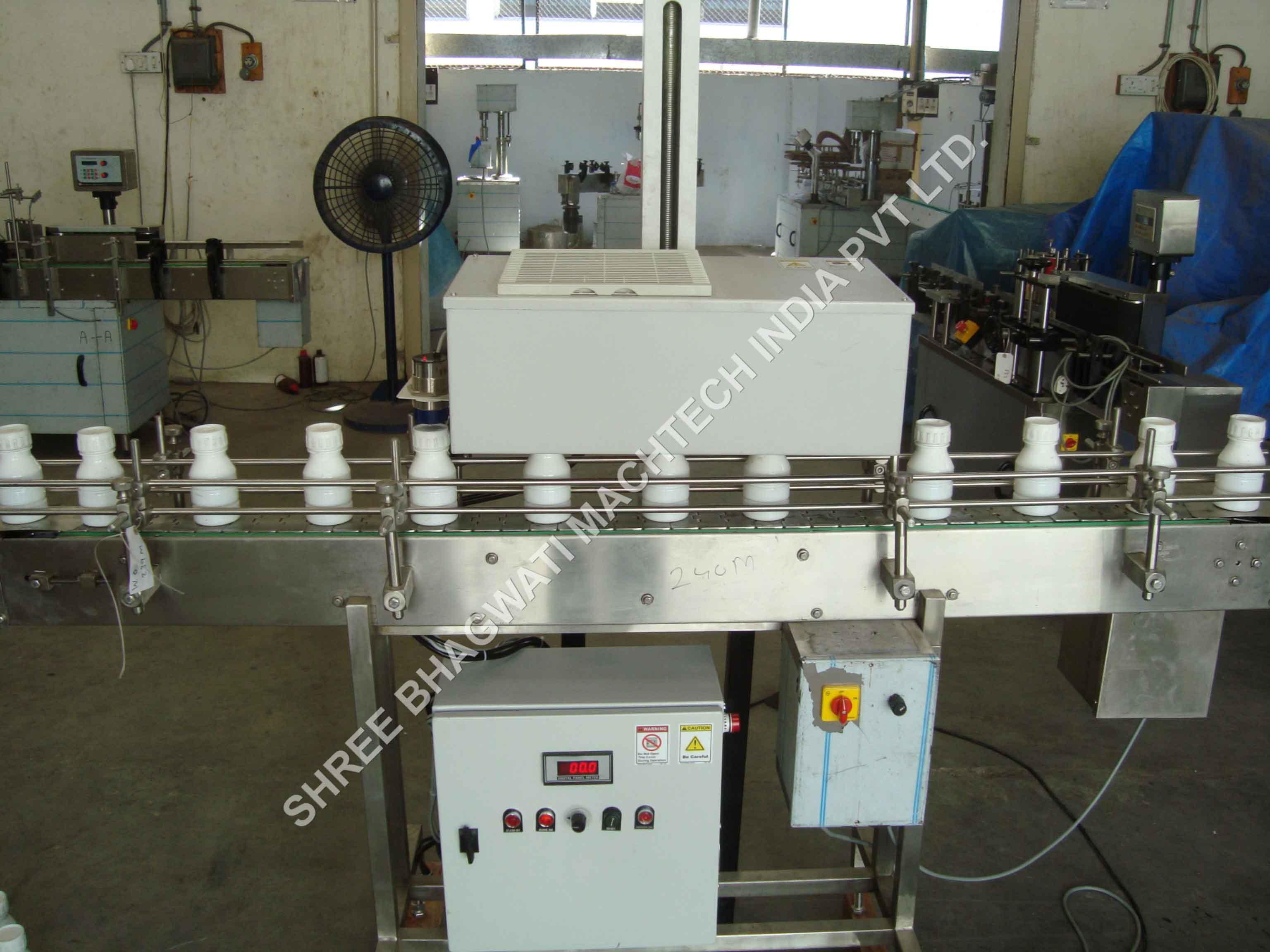 induction cap sealing machine manufacturer.